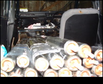 30 X 1.8m tubes in a small car.JPG